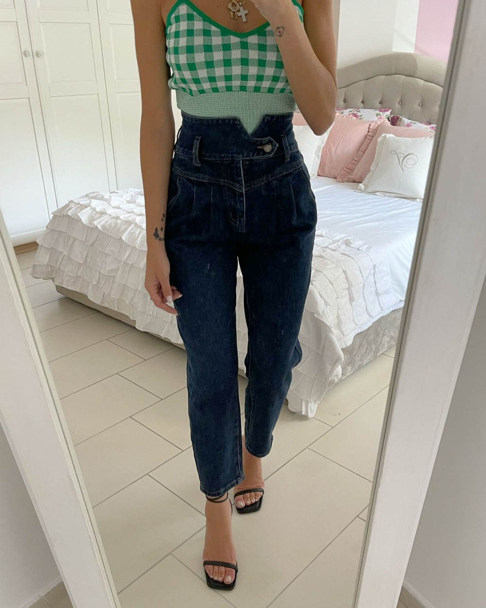 Jeans bottone laterale